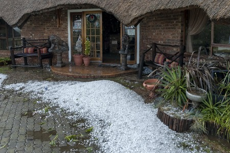 guest house: Big quantity of ice ball by guest house after hailstorm