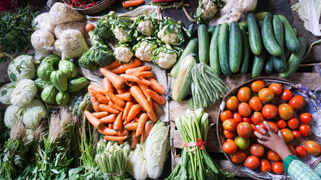 Fresh vegetables on sale in the Indonesian local market - carrots, cucumbers, corn, tomatoes, chillies, mustard greens Reklamní fotografie