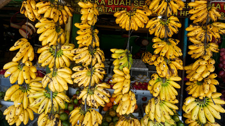 Fruit shops in traditional markets in Indonesia sell bananas that are neatly arranged and displayed in front of the shop