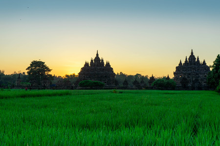 the view of the sunrise in a village with a plaosan buddhist temple background in Yogyakarta, Indonesia - Asia