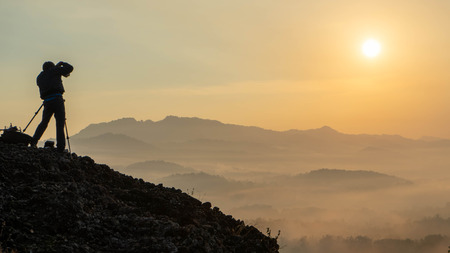 sunrise views in the summer that emerge from the hills in a village with photographer sillhouette Reklamní fotografie
