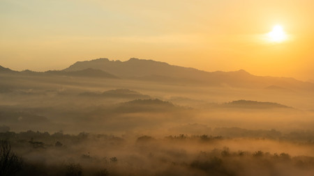sunrise views in the summer that emerge from the hills in a village