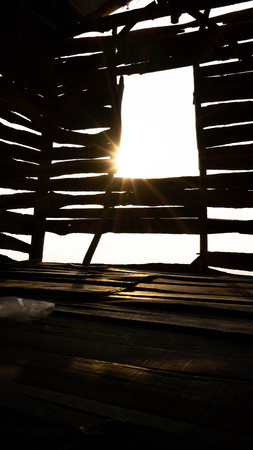 sunshine in the morning that goes through the crack of the wooden house window Reklamní fotografie
