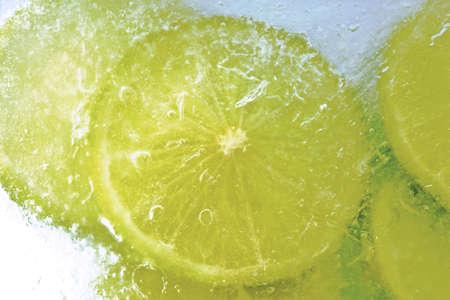 citrons: Lime slices, frozen, close-up