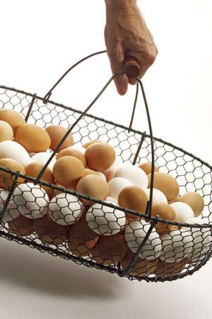 juxtaposing: Basket with fresh eggs