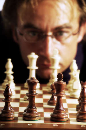 strategical: Man playing chess