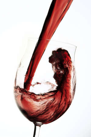fill in: Red wine pouring into glas LANG_EVOIMAGES