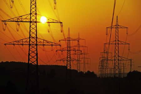 generic location: Electricity pylons and power lines, at sunset