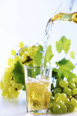 and grape juice: Grape juice been poured into glass