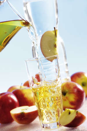 Pouring apple juice into glass