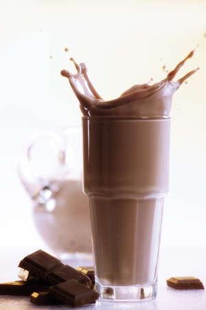 foodstill: Chocolate milkshake and piece of chocolate, close-up