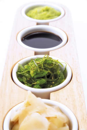 soysauce: Sushi ingredients: soy sauce, ginger and wasabi