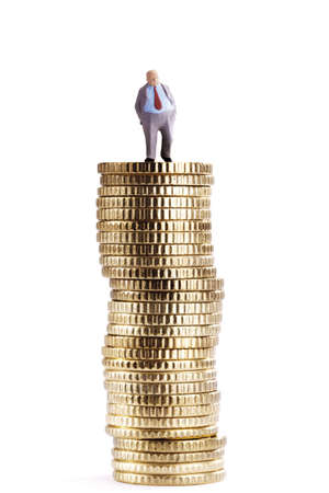 triumphing: Figurine on pile of coins LANG_EVOIMAGES