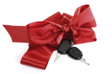 Car keys with red bow, close-up Stock Photo - 23584287