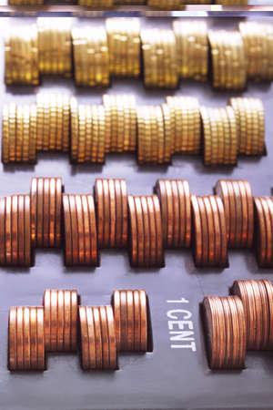 juxtaposing: Cent coins in cash box