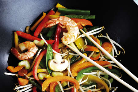 Vegetables and prawn cooked in wok with chopping sticks Stock Photo - 23707715