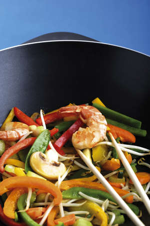 Vegetables and prawn cooked in wok with chopping sticks Stock Photo - 23674822