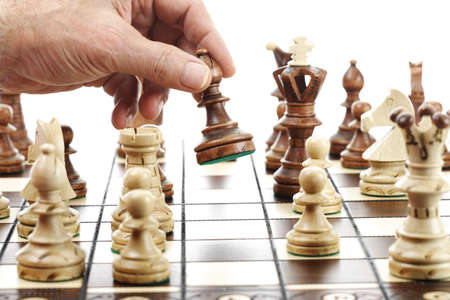 differential focus: Man moving knight on chessboard LANG_EVOIMAGES