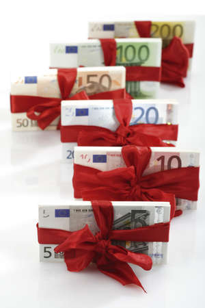 Bunches of banknotes tied as gift, close-up Stock Photo - 23707775