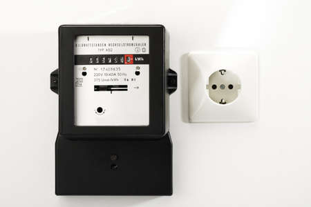 electricity meter: Electricity meter and socket, close-up LANG_EVOIMAGES