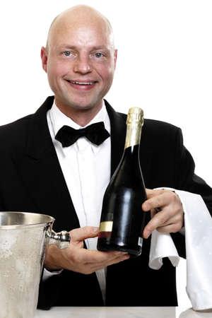 mirthful: Bartender holding bottle of sparkling wine, portrait