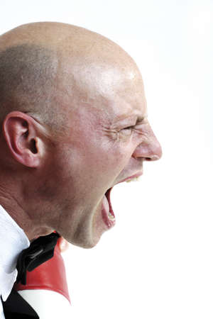 infuriate: Man screaming, close-up LANG_EVOIMAGES
