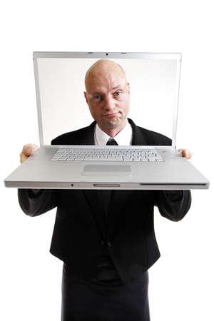 technolgy: Man looking through screen of lap top