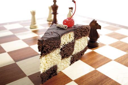 differential focus: Piece of chess cake on chess board
