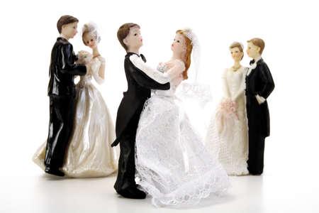 confiding: Three wedding couple figurines