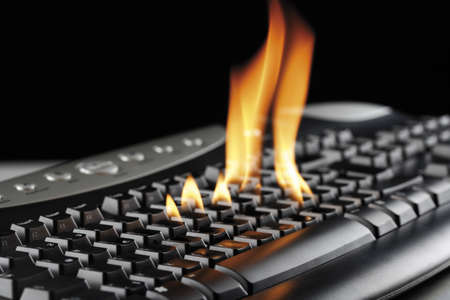 Burning computer keyboard, close-up
