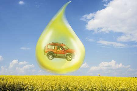 digital composite: Oil drop with car above rape field (digital composite)