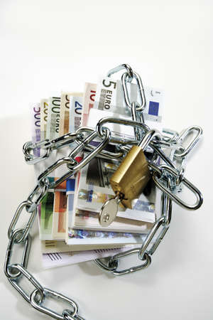 meanness: Bunches of Euro banknotes in chains LANG_EVOIMAGES