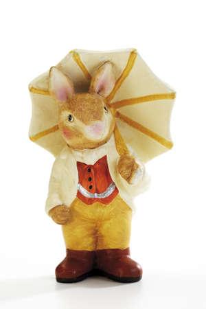 traditon: Easter bunny holding umbrella