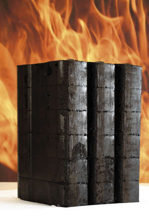 piled: Piled briquettes, fire in background LANG_EVOIMAGES