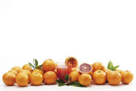 juxtaposing: Blood oranges and glass of juice
