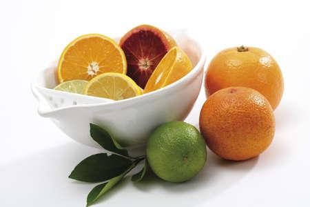 juxtaposing: Sliced citrus fruits in bowl