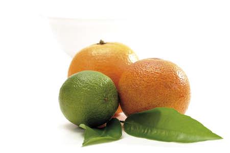 citrous: Three citrus fruits, bowl in background LANG_EVOIMAGES