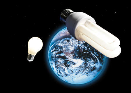 digital composite: Energy saving lamp and electric bulb, image of earth in space in background, (digital composite) LANG_EVOIMAGES
