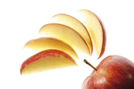 sliced apple: Sliced apple and whole fruit, close-up