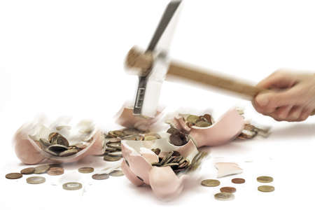 egoistic: Hammer smashing piggy bank with Euro coins, close-up LANG_EVOIMAGES