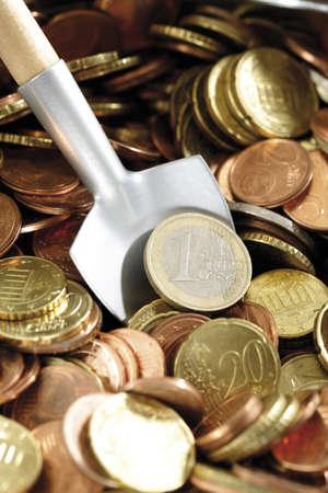 accumulating: Shovel in Euro coins, (symbol for accumulating money), close-up LANG_EVOIMAGES