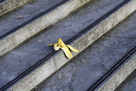 untidily: Banana peel lying on stairs