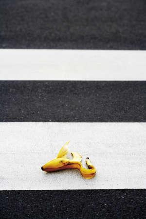 untidily: Banana peel lying on crosswalk