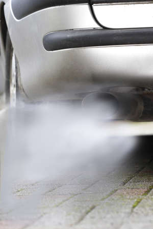 smog: Car exhaust pumping out of fumes, close-up
