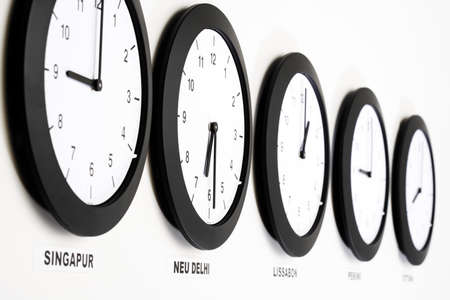 juxtaposing: Clocks on wall, close, up, symbol for Greenwich Mean Time