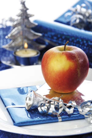 Christmas place setting with apple ans parcel Stock Photo - 23707919