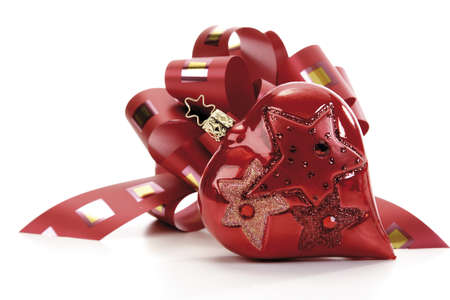 interiour shots: Red gift ribbon with heart-shaped Christmas tree decoration