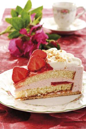 interiour shots: Strawberry-cream cake on plate, close-up