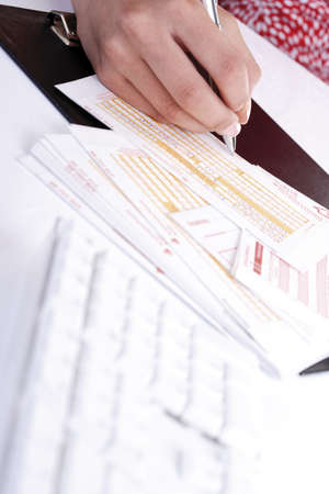 deposit slip: Person filling in a money transfer form