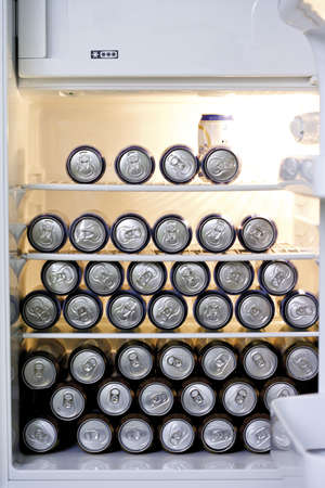 interiour: Fridge filled with cans of beer